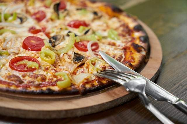 Foto de Pizza cocinada en Horno de leña